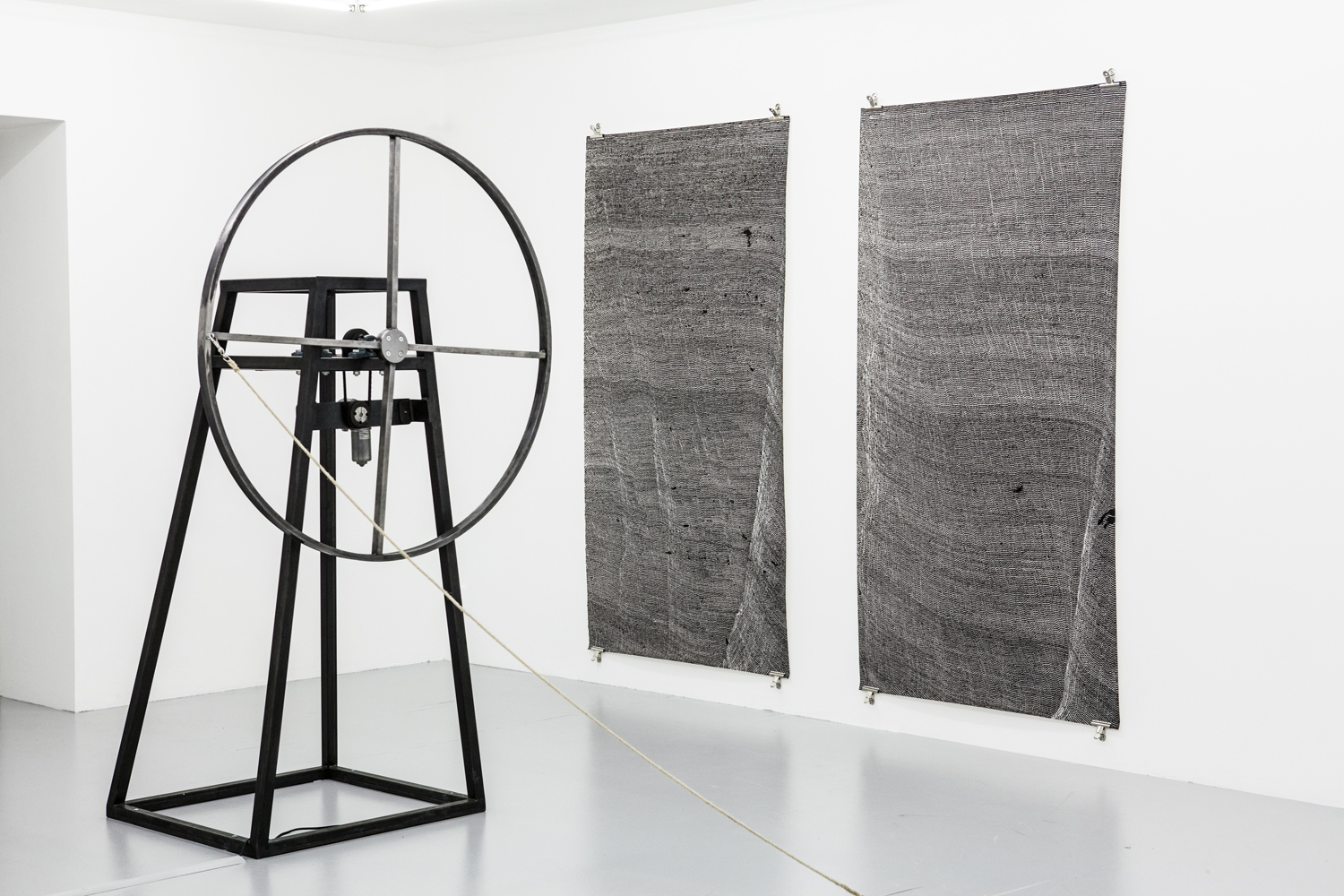 Linda Matalon, Untitled, 2013, wax, graphite on paper / Amalia Pica, Playing solo and indoors (mechanical jump rope), 2013, steel, motor, rope / Signal to Noise, Installation shot, Gallery Niklas Belenius, Stockholm